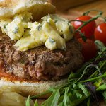 Inverted Cashel Blue Cheeseburger with Roasted Tomatoes and Red Onion Salad
