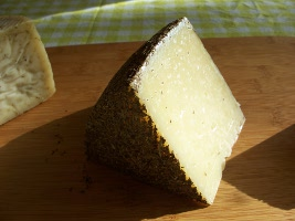 Manchego with rosemary-coated rind